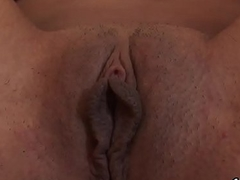 Lovesome kitten is gaping soft vagina in close up and having orgasm