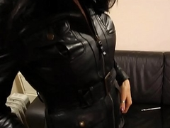 Mummy in long leather skirt, leather boots and leather jacket
