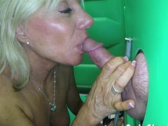Mature Blonde giving public blowjobs to strangers